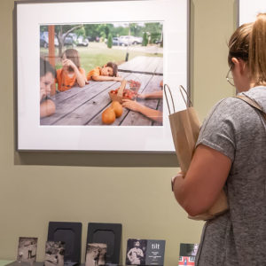 image of young woman looking at photo on wall