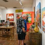 people looking at artwork in a gallery