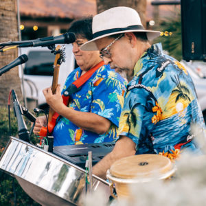 musicians playing the guitar and steel drums in Hawaiian shirts